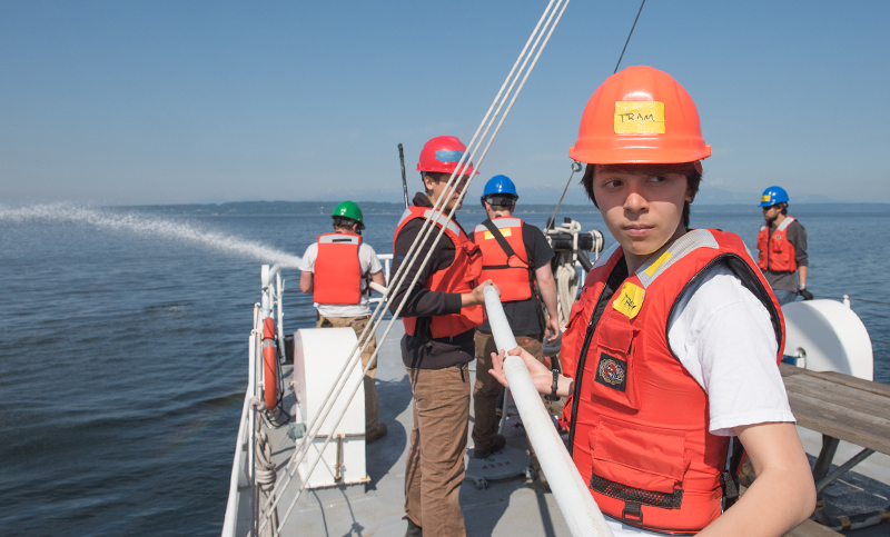 picture of student learning maritime equipment on a boat